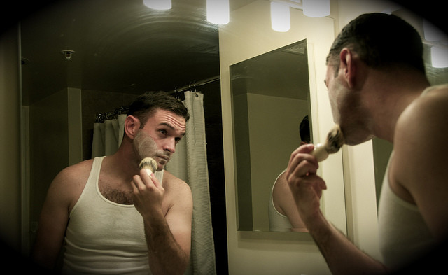 man using brush and soap